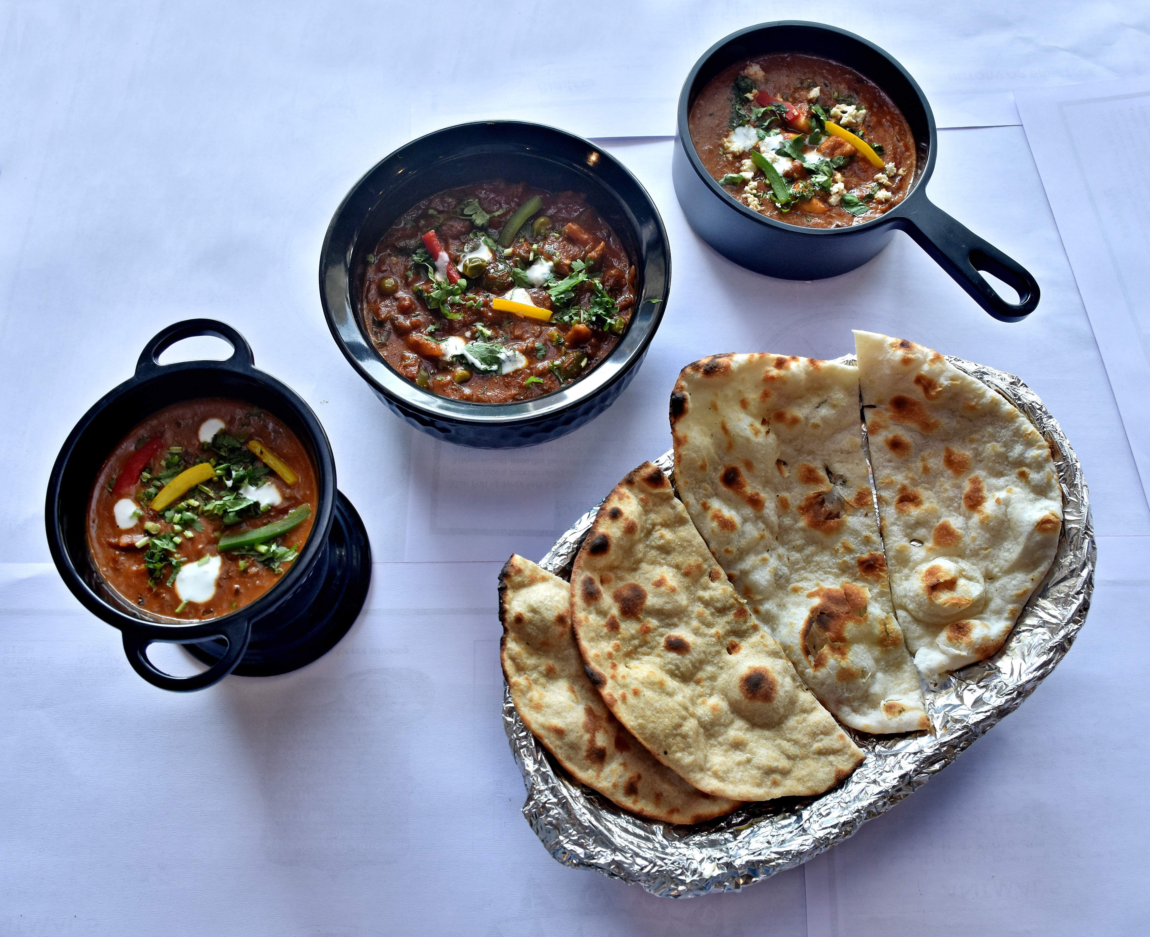 Dal makhani, paneer makhani and Penang curry with assorted breads