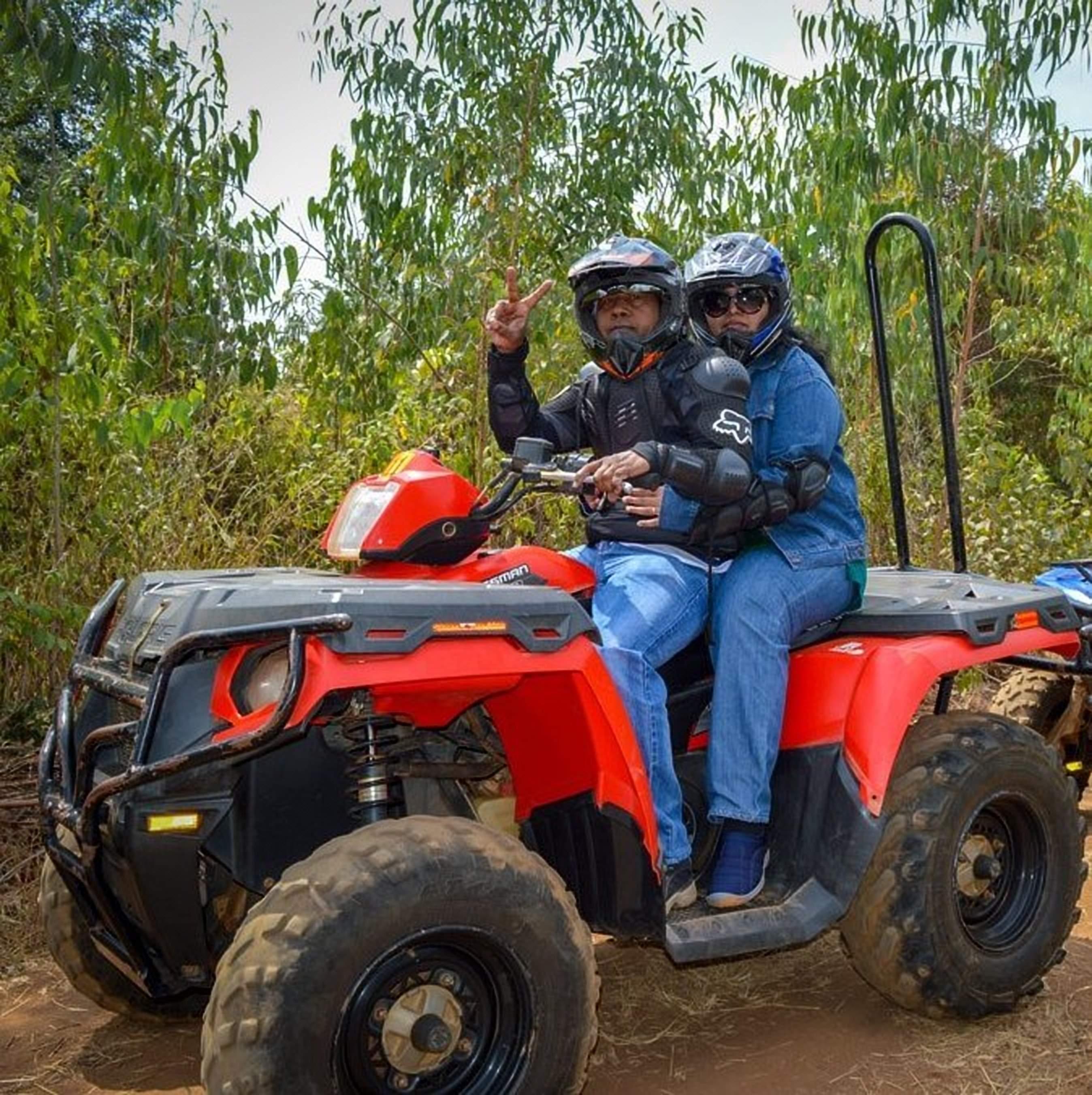 Sandy and Vyjay riding an ATV at Dirt Mania