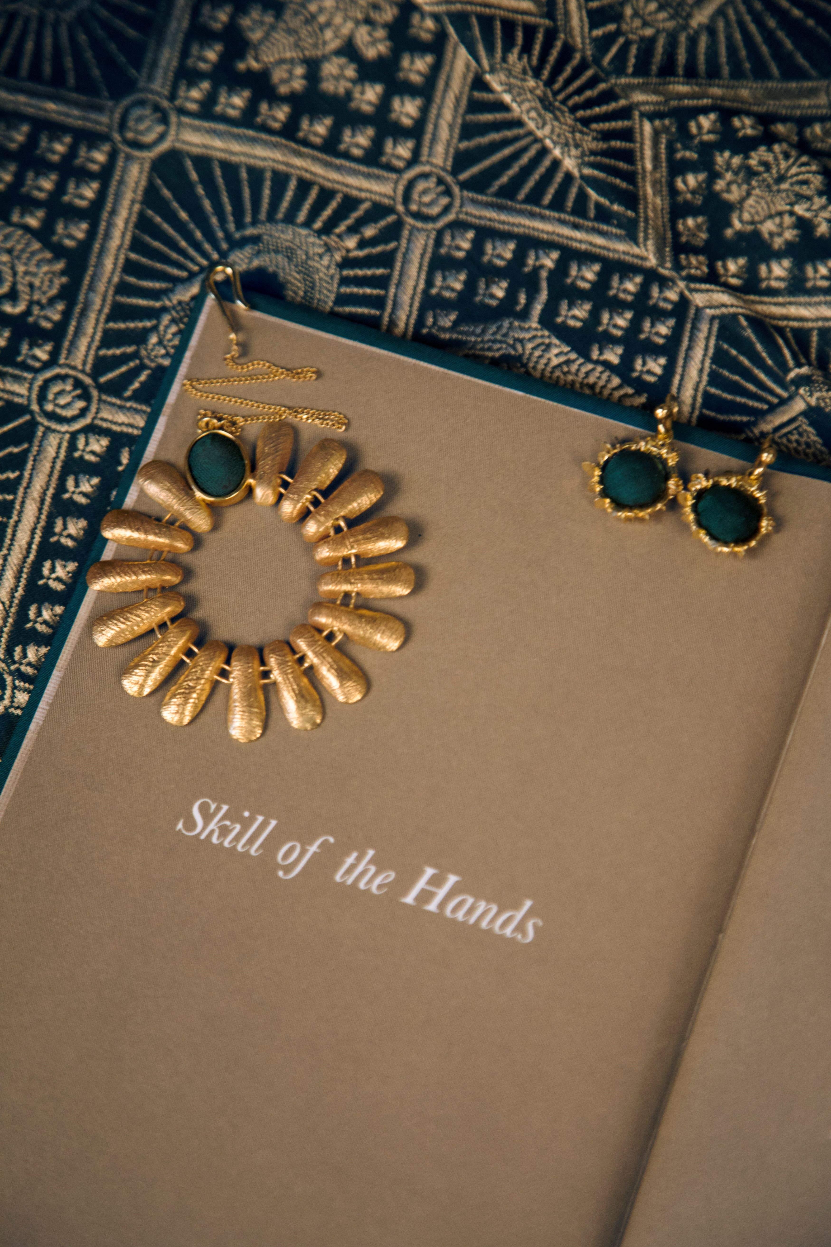 Gold emerald maang tikka and mini gold emerald green Inodaya earrings
