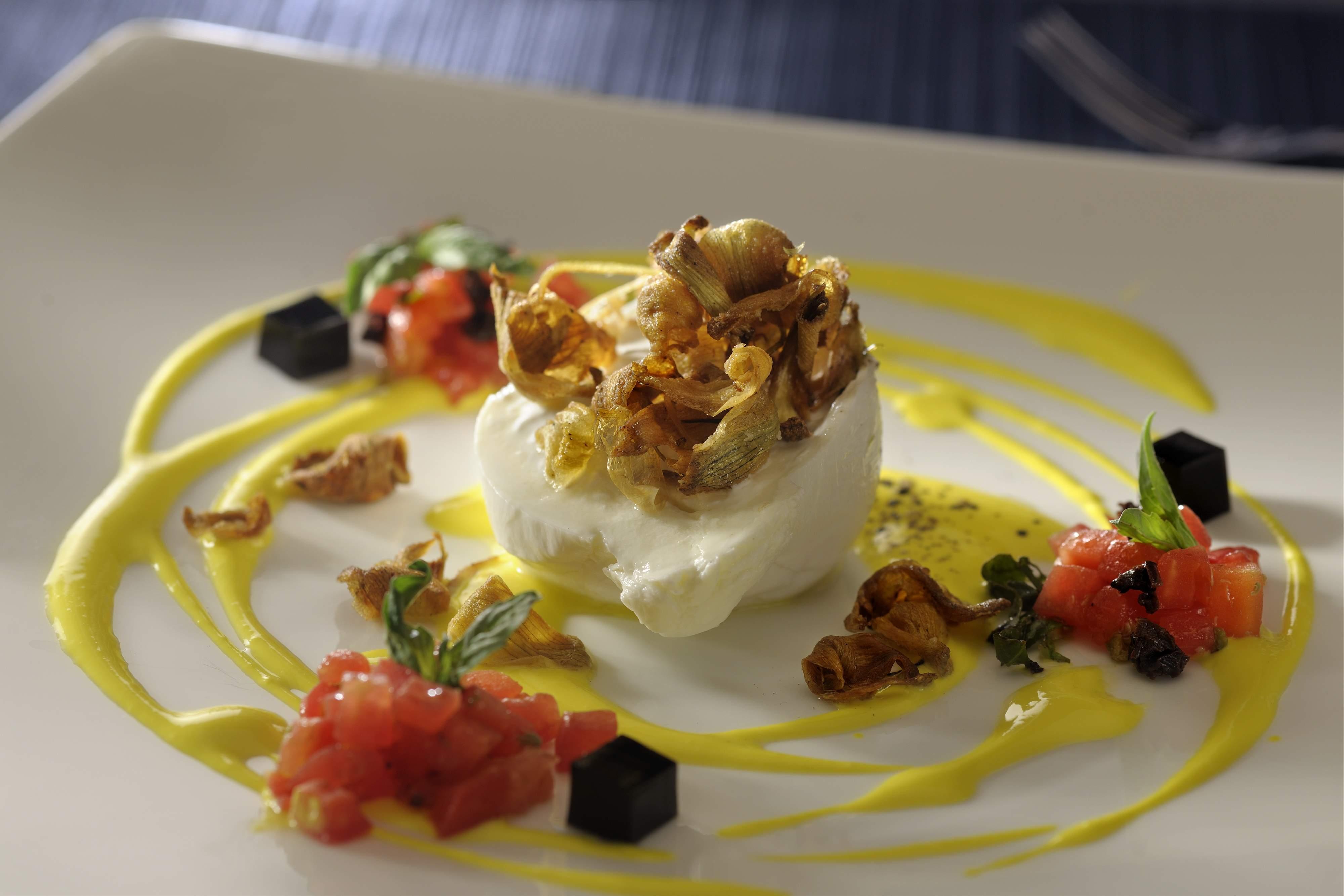 Monk-crafted Burrata, heirloom tomato tartare, creamed yellow squash, artichoke and basil essence