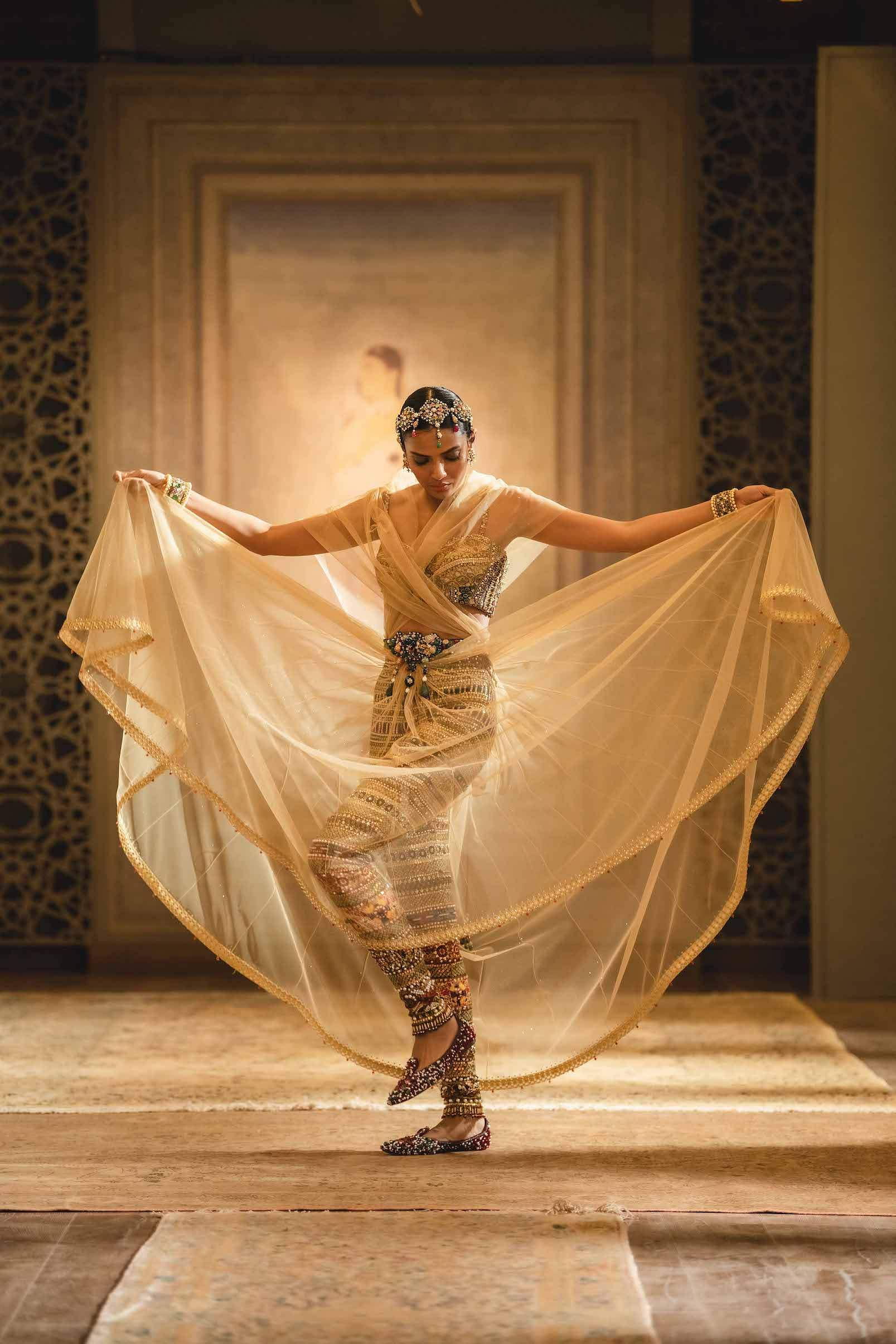 Zardosi-embroidered leggings and pearl-and-stone-embroidered bustier worn with a voluminious skirt and shirred drape