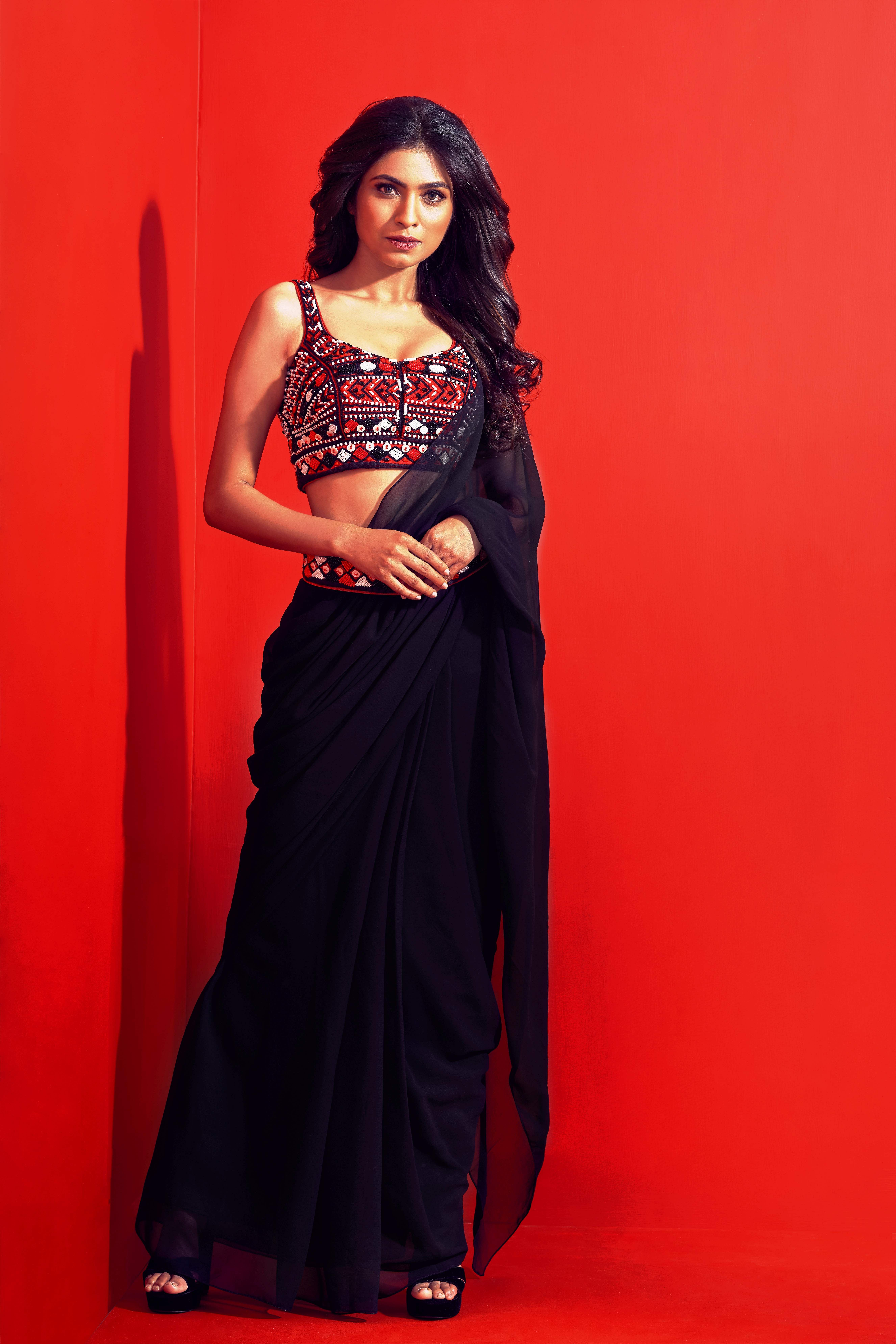Structured sari with tribal motifembellished blouse