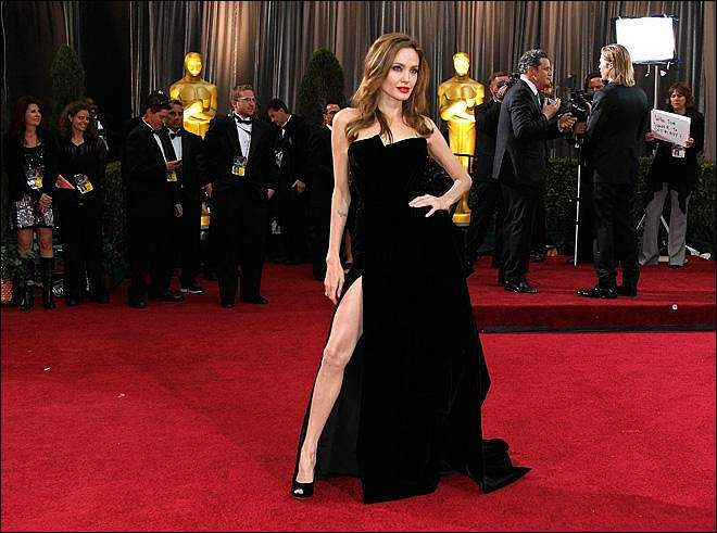 Angelina Jolie with her famous one-leg-bared pose at the Oscars