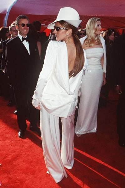 Celine Dion wearing a backward tuxedo and top hat for the Oscars