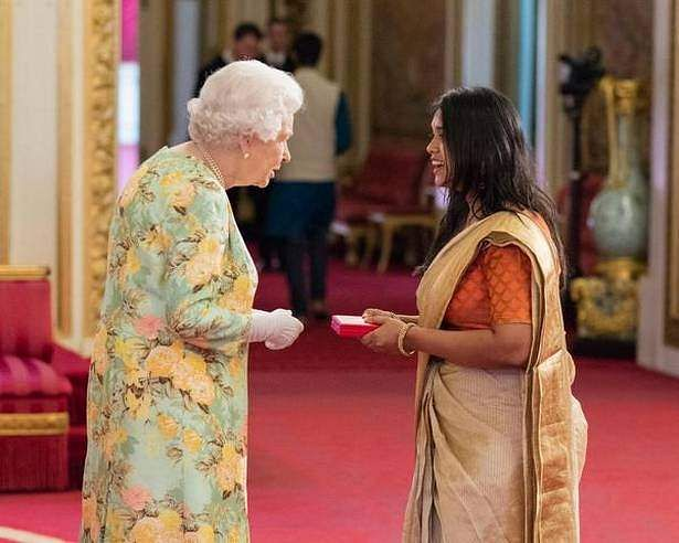 Deane De Menezes with HM Queen Elizabeth II at the Buckingham Palace