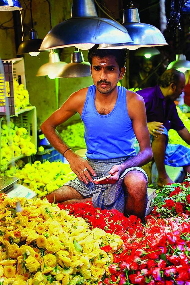Portrait of a flower vendor by Aishwarya Ashok