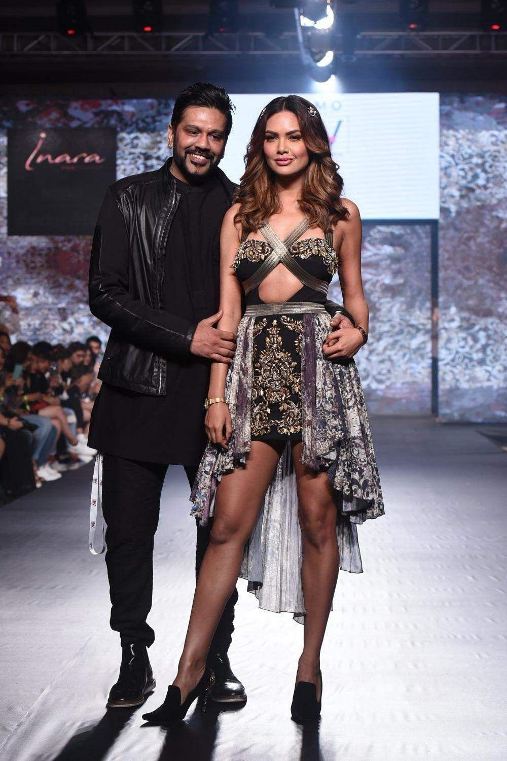 Actress Esha Gupta with designer Rocky S during India Beach Fashion Week in Goa