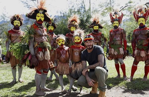 Beckham with indigenous tribesmen in Western Highlands Province, Papua New Guinea