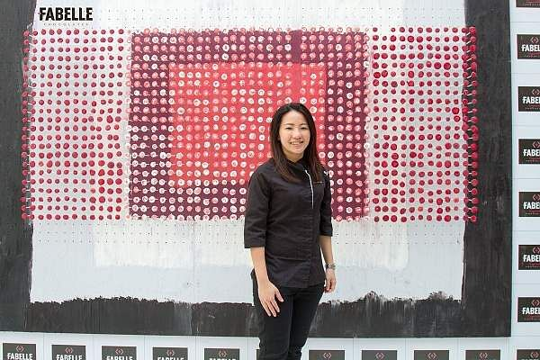 Janice_Wong_with_the_1000_chocolate_lollipops_installation