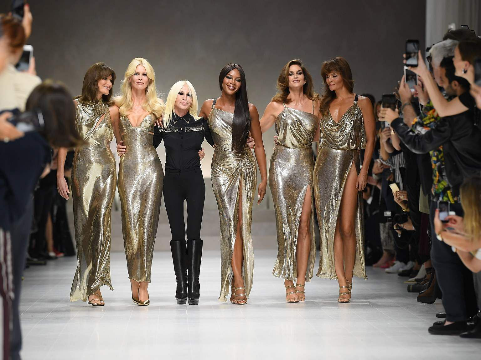 Donatella Versace (in black) with Carla, Claudia, Naomi, Cindy and Helena