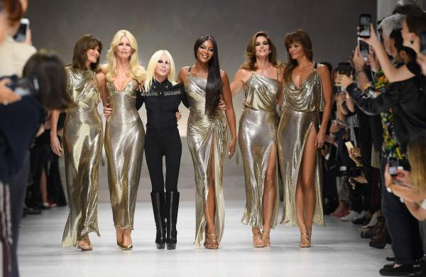 Donatella Versace (in black) with Carla, Claudia, Naomi, Cindy and Helena