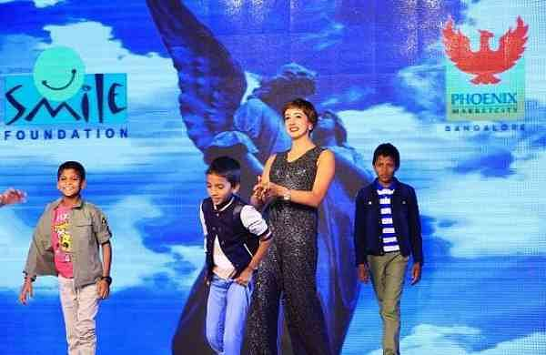Sanjjanaa Galrani (Indian model and film actress) with Smile Foundation kids