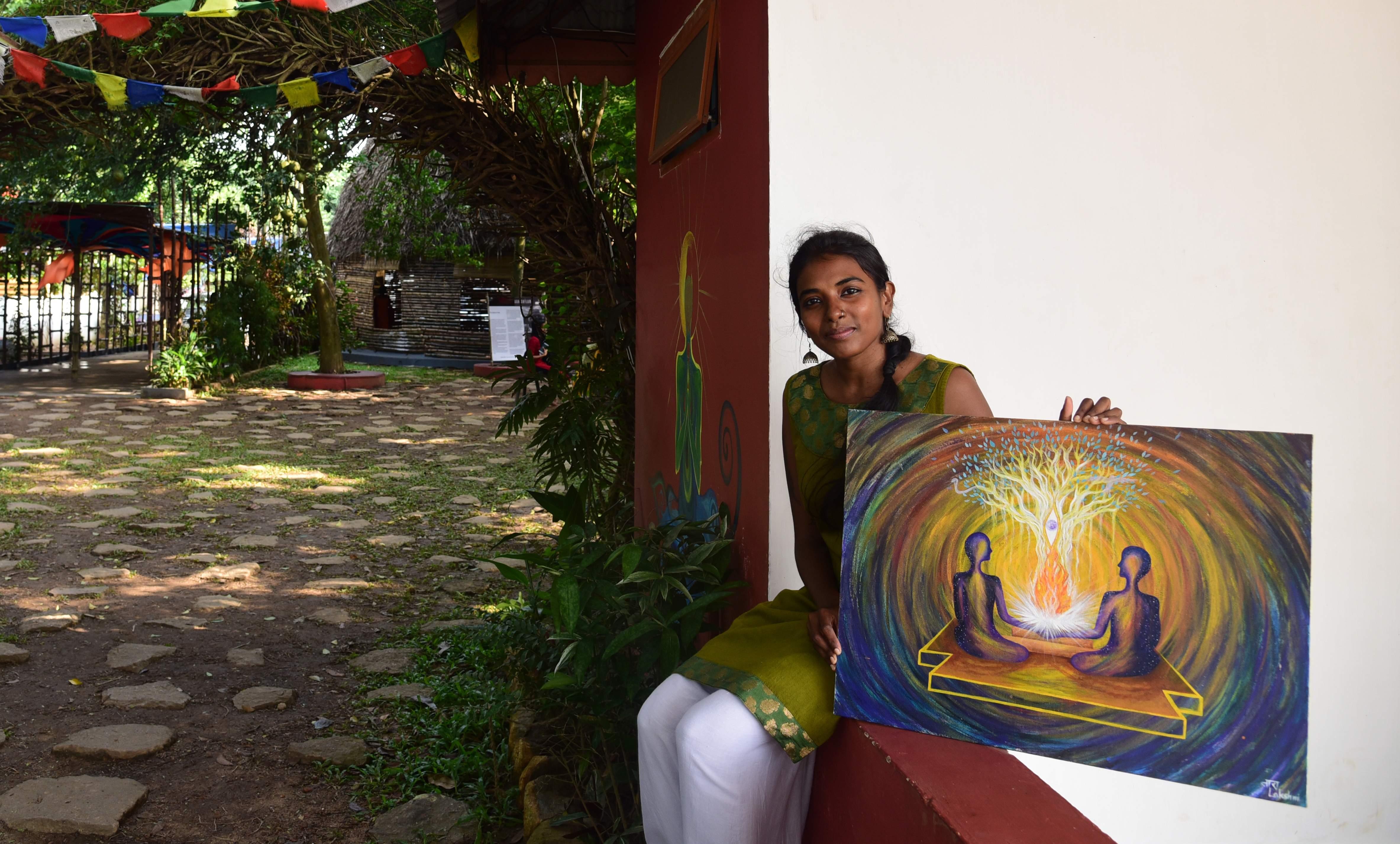 Lakshmi Tara with her painting