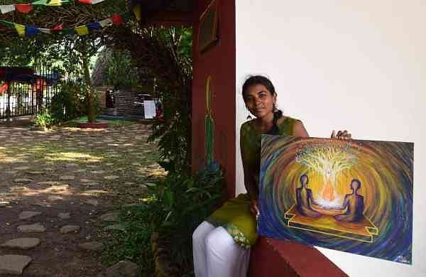 Lakshmi Tara with her painting