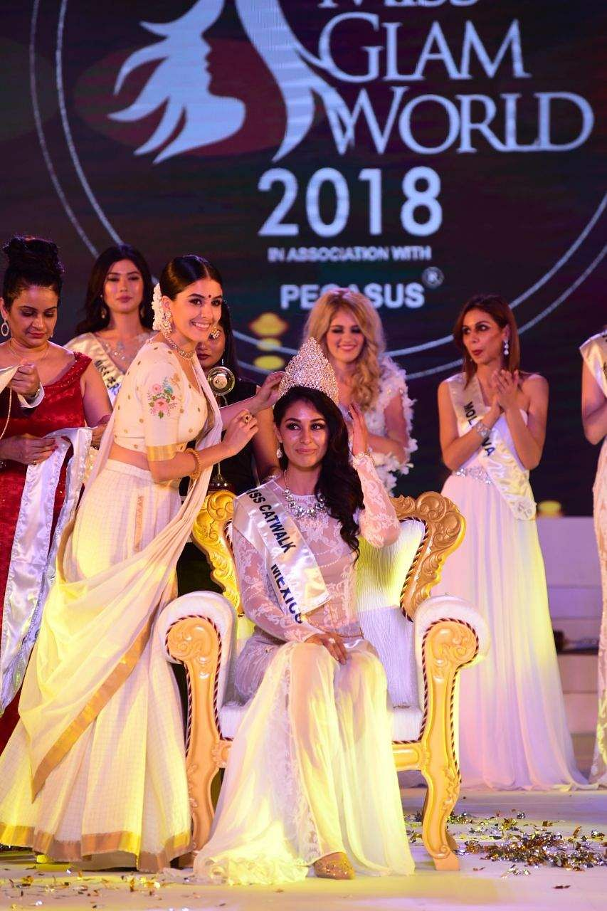 Mexico's Estefania Chavez Garcia being crowned Indulge Miss Glam World 2018 in Kochi, on Friday.