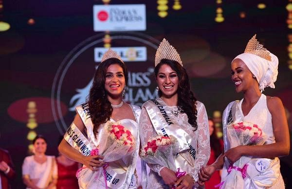 Indulge Miss Glam World 2018 winners Estefania Chavez Garcia from Mexico, Fahima Abdi from Kenya and India's Aileen Amon share a light moment after being crowned by the judges.