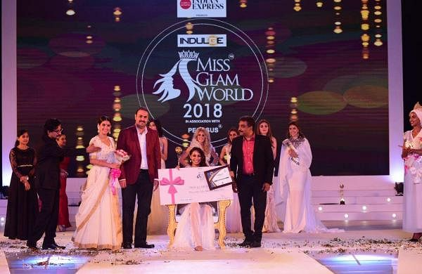 Indulge Miss Glam World 2018 winner from Mexico, Estefania Chavez Garcia poses with her prize money in Kochi, on Friday.