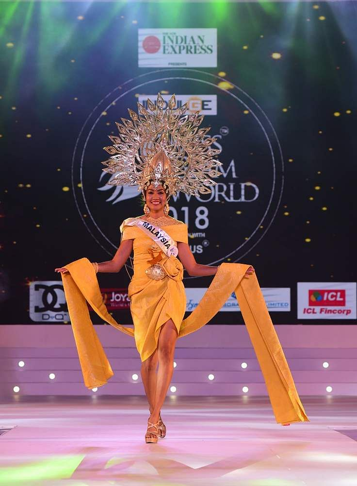 Malaysia's Tanalaksiumy Rayer walks the ramp in her colourful attire at Indulge Miss Glam World 2018.