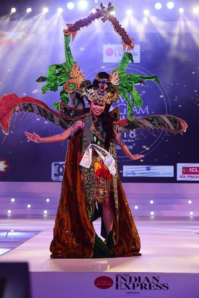Indonesia's Jihan Putri walks the ramp in colourful traditional attire at Indulge Miss Glam World 2018