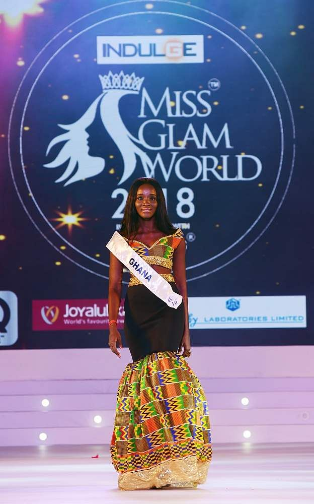 Ghana's Peninnah Takyi walks the ramp in black and yellow prints at Indulge Miss Glam World 2018.