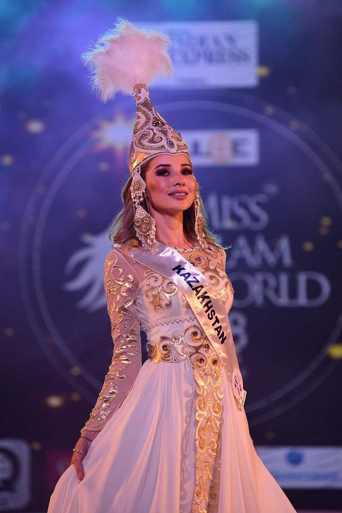 Kazakhstan's Nurjan Janypyeis walks the ramp in her fairy-like attire at Indulge Miss Glam World 2018