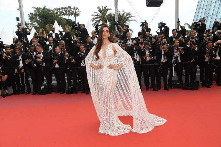 Deepika Padukone looked heavenly in a white gown designed by Zuhair Murad on the red carpet at Cannes 2018