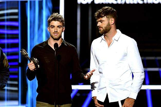 Recording artists Andrew Taggart and Alex Pall of music group The Chainsmokers accept the Top Dance/Electronic Artist award.