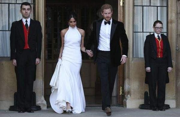 Meghan Markle in her evening dress with Prince Harry leaving for the royal wedding reception.
