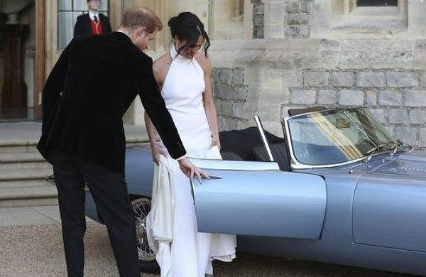 Prince Harry and his wife, Meghan Markle leave for the reception.