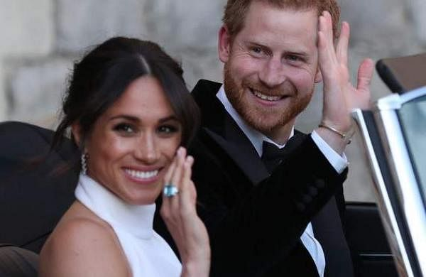 Meghan Markle and Prince Harry enroute their wedding reception.