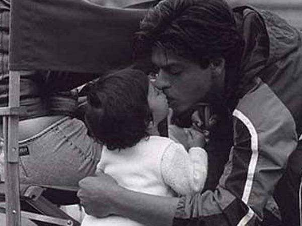 A candid picture of Shah Rukh Khan kissing daughter Suhana Khan