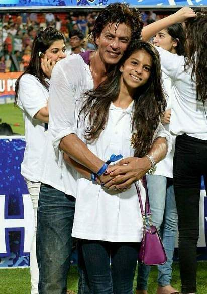 Shah Rukh Khan poses with his teenager daughter Suhana Khan at an IPL match