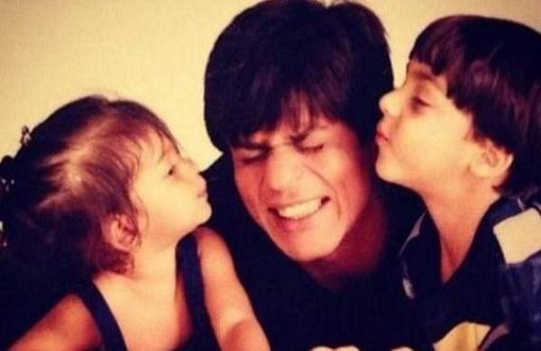 Suhana Khan and Aryan Khan posing for a picture with Shah Rukh Khan