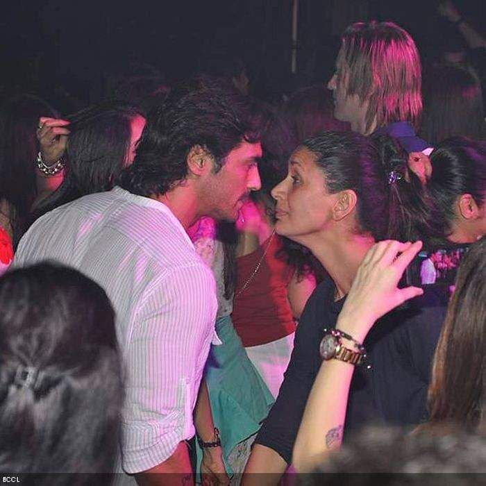 Arjun Rampal and Mehr Jessia at a party