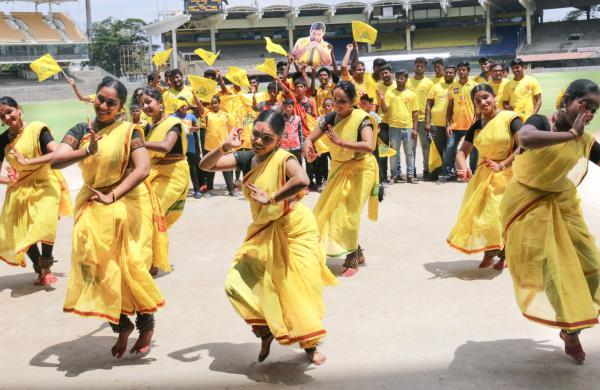 CSK fans dancing at Chepauk stadium