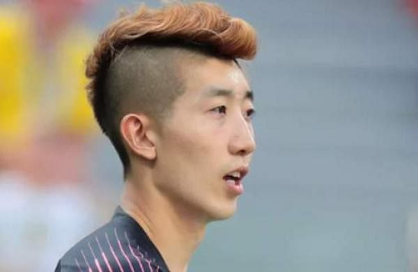 South Korean keeper Cho Hyun-woo sports a fluffy coloured mohawk.