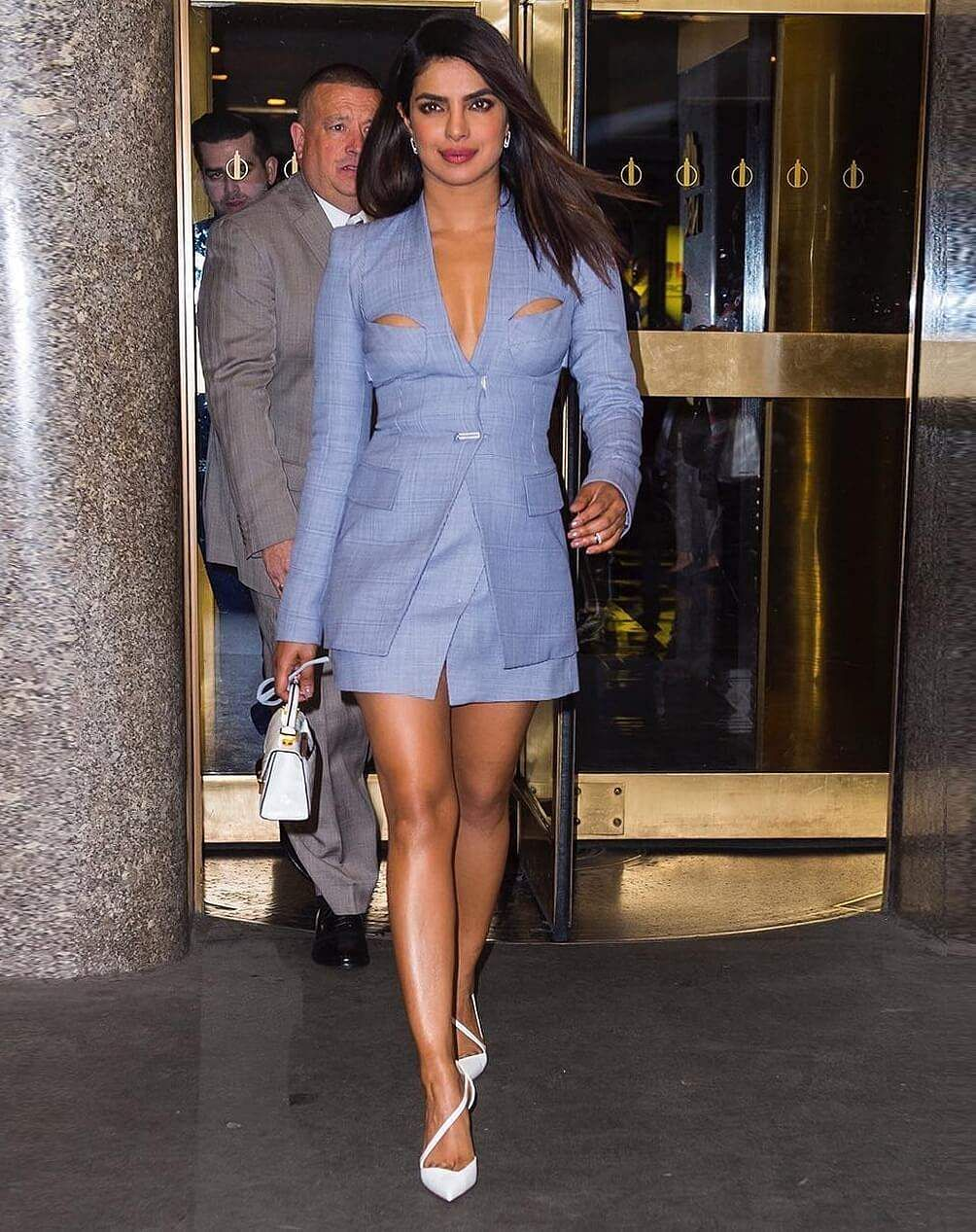 Priyanka in a lingerie blazer dress by Dion Lee teamed with white Christian Louboutin heels