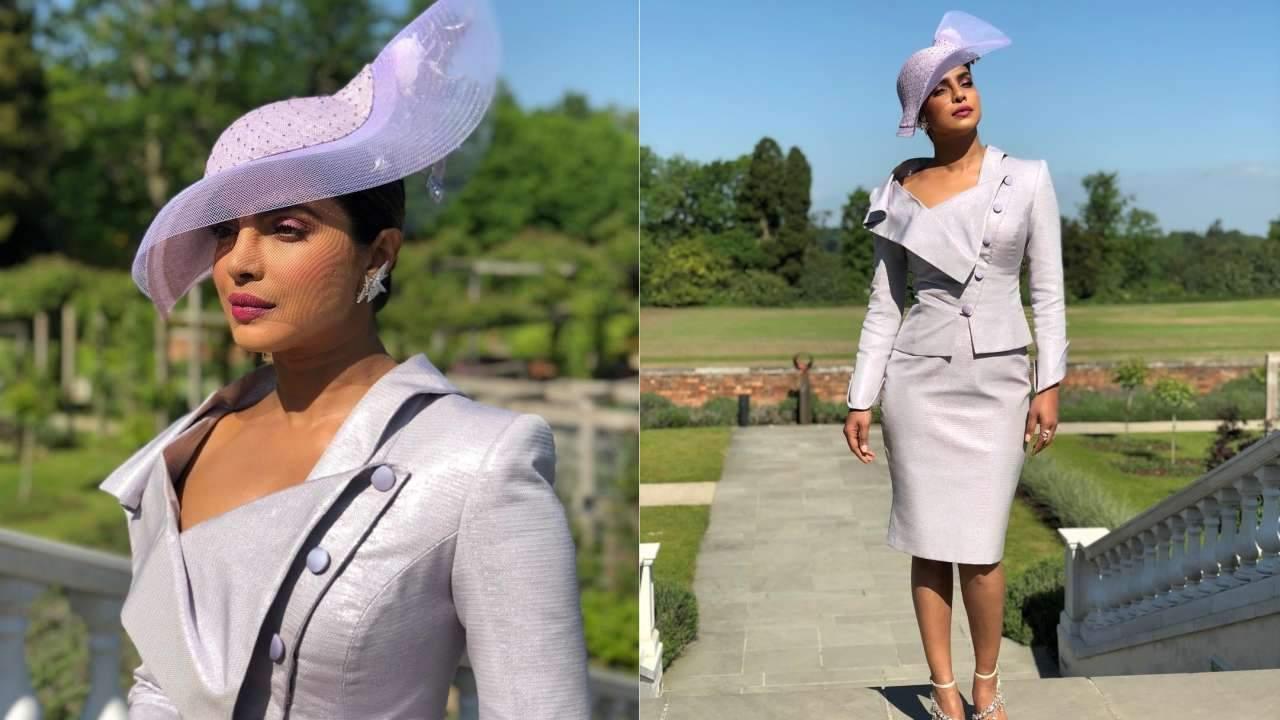 Priyanka Chopra wearing a lilac Vivienne Westwood attire teamed with a matching fascinator hat for Harry- Meghan royal wedding
