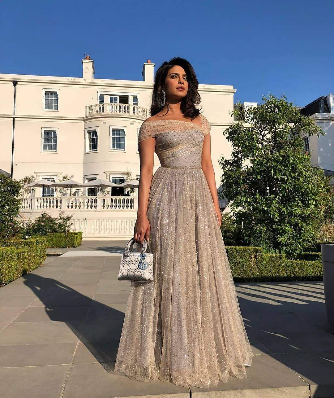 Priyanka in a sheer sparkling gold Dior gown for Harry- Meghan wedding reception