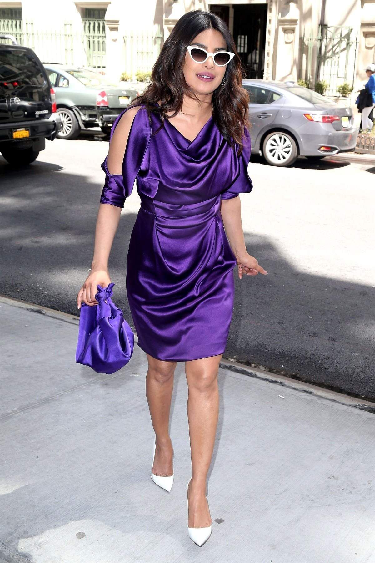 Priyanka in a violet Vivienne Westwood mini paired with matching tote and while heels