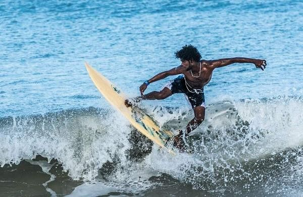 One of the many surfers at Covelong Point