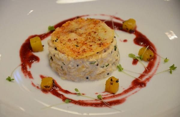 Curd_Oats_with_Parmesan_Crisps_prepared_by_Vikas_Khanna