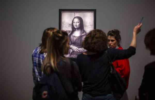 At the Louvre museum (AP Photo/Rafael Yaghobzadeh)
