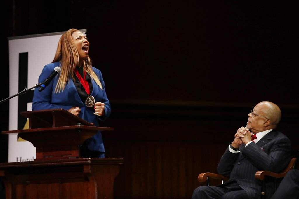 Music artist and actress Queen Latifah shouts during her speech as Professor Henry Louis Gates, Jr listens after she received the W.E.B. Dubois Medal at Harvard University. (AP Photo/Elise Amendola)