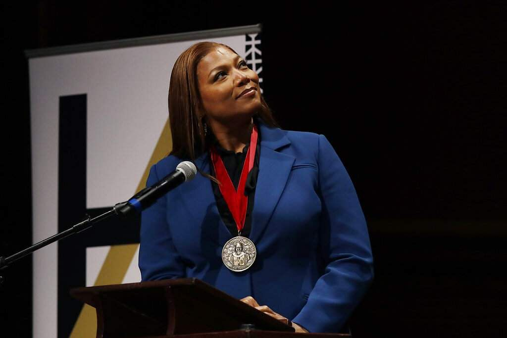 Music artist and actress Queen Latifah reacts after receiving the W.E.B. Dubois Medal for her contributions to black history and culture at Harvard University. (AP Photo/Elise Amendola)