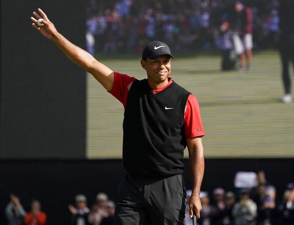 Tiger Woods gestures after winning the Zozo Championship PGA Tour at the Accordia Golf Narashino country club in Inzai, east of Tokyo, Japan. (AP Photo/Lee Jin-man)