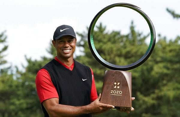 Tiger Woods poses with his trophy after winning the Zozo Championship PGA Tour at the Accordia Golf Narashino country club in Inzai, Japan. (AP Photo/Lee Jin-man)