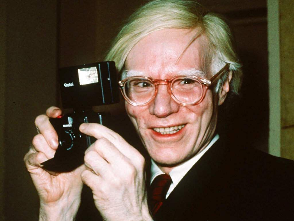 In this file photo dated 1976, showing pop artist Andy Warhol smiles in New York.  (AP Photo/Richard Drew, FILE)