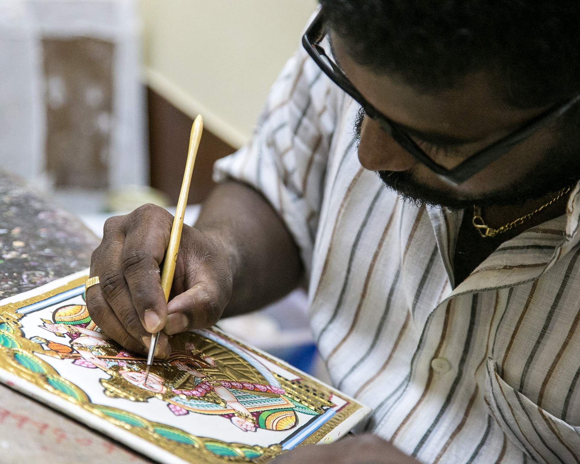 A Tanjore artist at work