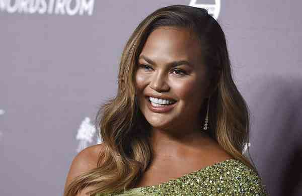 Chrissy Teigen arrives at the 2019 Baby2Baby Gala (Photo by Jordan Strauss/Invision/AP)